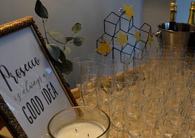Champagnebar champagne prosecco glazen flutes glitter goud
